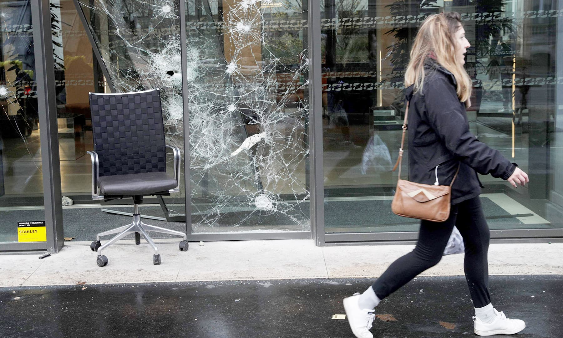 Protestors damaged the front facade of many buildings. —AFP