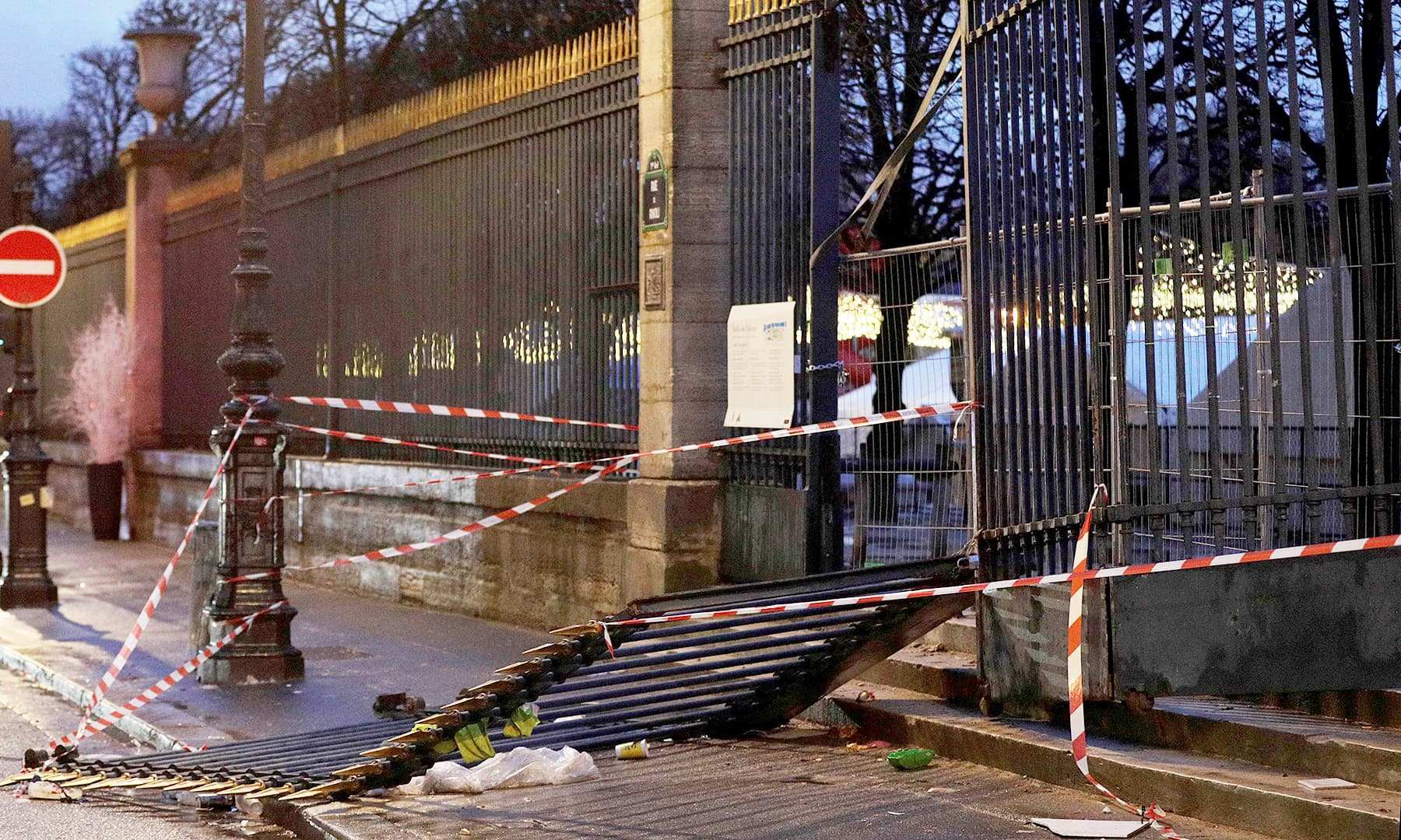 The damaged gates of the Tuileries Gardens. —AFP