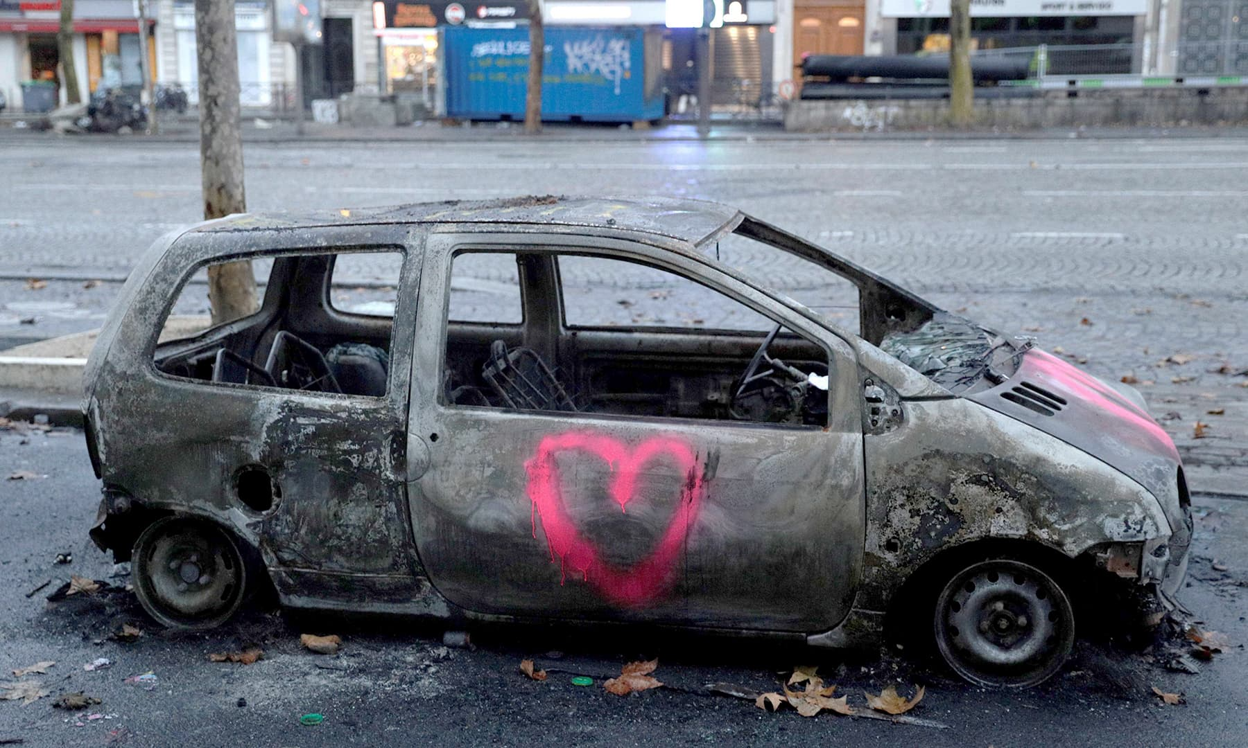 Dozens of cars were left burning in the worst riot in a decade. —AFP