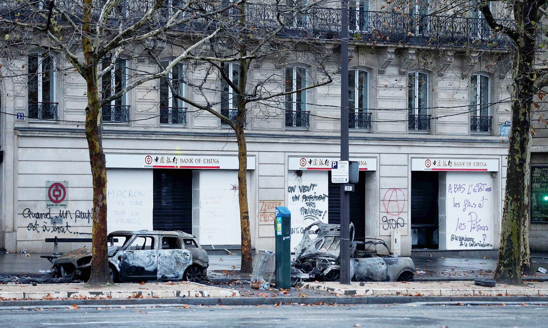 Burned down cars and graffiti littered walls presented a sombre picture the following morning. —AFP