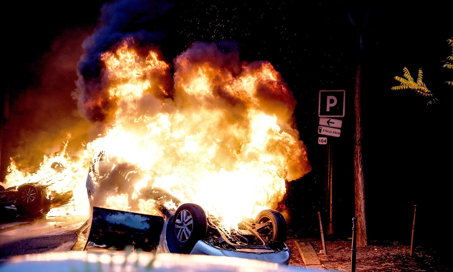 A car burns on the sideline of a demonstration by Yellow vests (Gilets jaunes). —AFP
