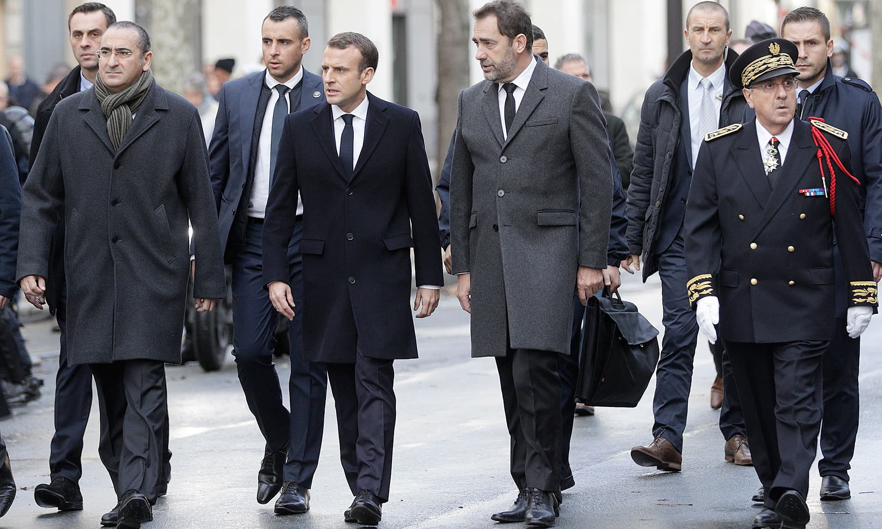 French President Emmanuel Macron (2ndL) flanked by Interior Minister Christophe Castaner (2ndR), Paris police prefect Michel Delpuech (R) and French Junior Minister attached to the Interior Ministry Laurent Nunez (L) surveying the damage. —AFP