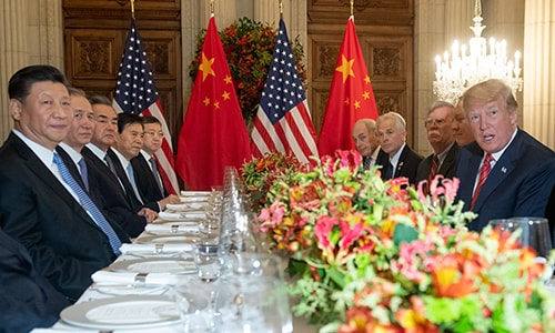 US President Donald Trump and China's President Xi Jinping along with members of their delegations, have dinner at the end of the G20 Leaders' Summit in Buenos Aires. — AFP