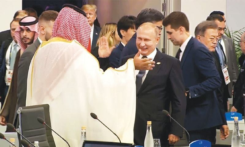 Russian President Vladimir Putin high-fives Saudi Crown Prince Mohammed bin Salman at the G20. — File