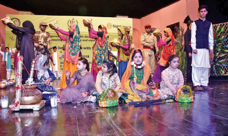 Special children perform a tableau at the PNCA on Monday. — APP