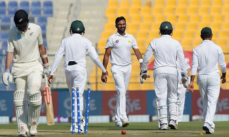 Bilal Asif (C) celebrates with teammates after taking the wicket of New Zealand batsman Will Somerville. — AFP