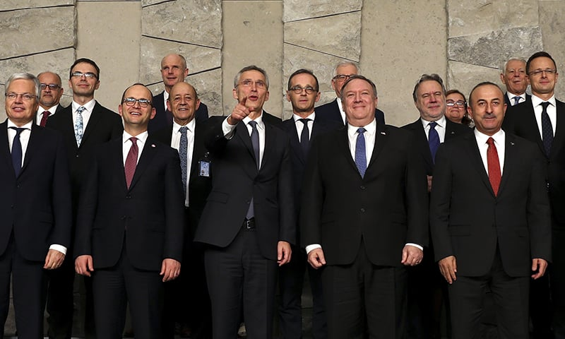 Nato Secretary General Jens Stoltenberg, front center, and US Secretary of State Mike Pompeo, front second right, with a group of NATO foreign ministers at NATO headquarters in Brussels, December 4, 2018. —AP