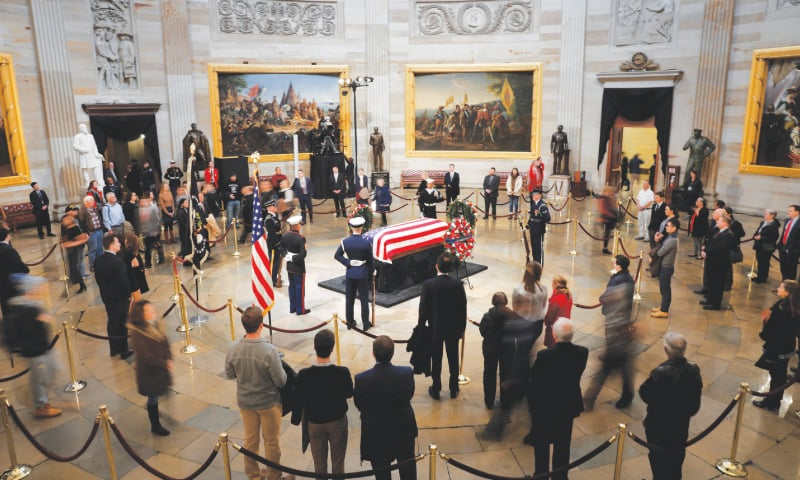 Mourners pay their respects to former US president George H.W. Bush inside the Capitol Rotunda on Tuesday. — Reuters