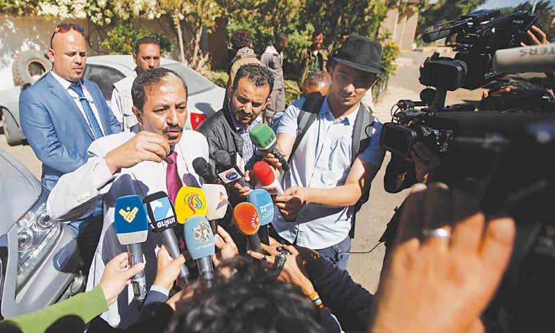 Sanaa: Abdul Majid Hanash, a member of the Houthi delegation participating in the negotiations in Sweden, speaks to the media before his departure from Sanaa airport on Tuesday.—Reuters