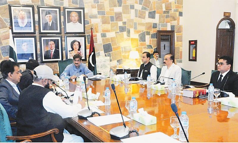 THE chief minister presides over the meeting at CM House on Tuesday.—PPI