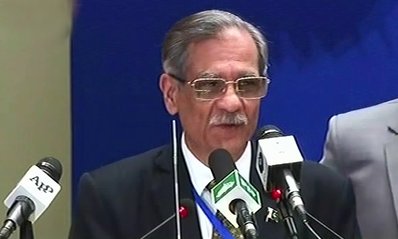 Chief Justice Saqib Nisar addresses the symposium. — DawnNewsTV