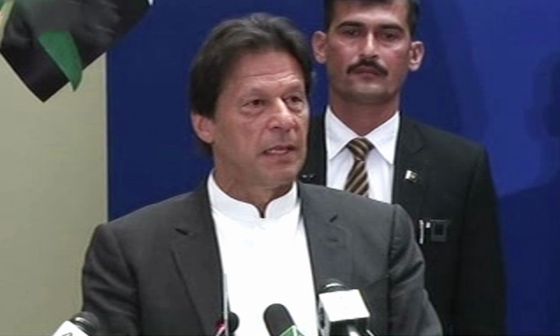 PM Imran Khan speaks at the symposium. — DawnNewsTV