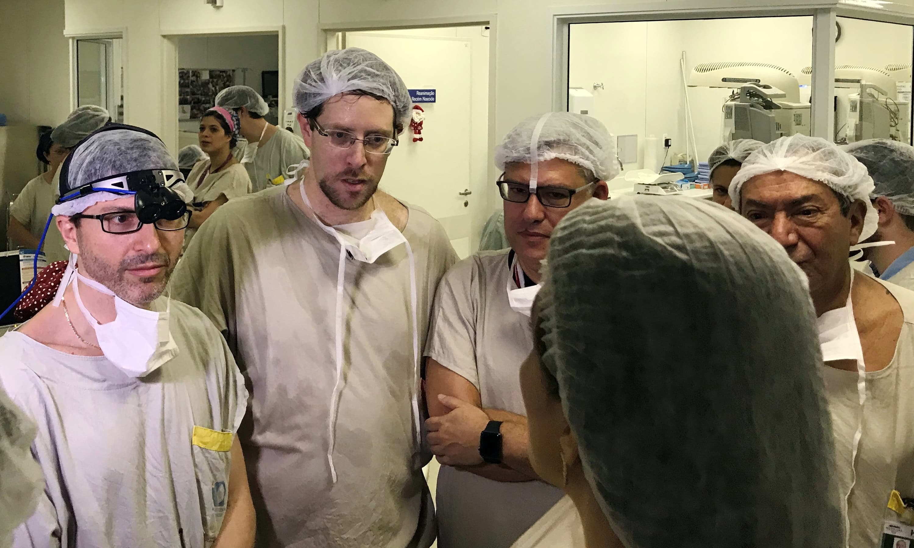 In this Dec 15, 2017, photo provided by transplant surgeon Dr. Wellington Andraus, left with magnifying glasses, he and Dr Dani Ejzenberg, second left, confer with colleagues at the hospital. —AP