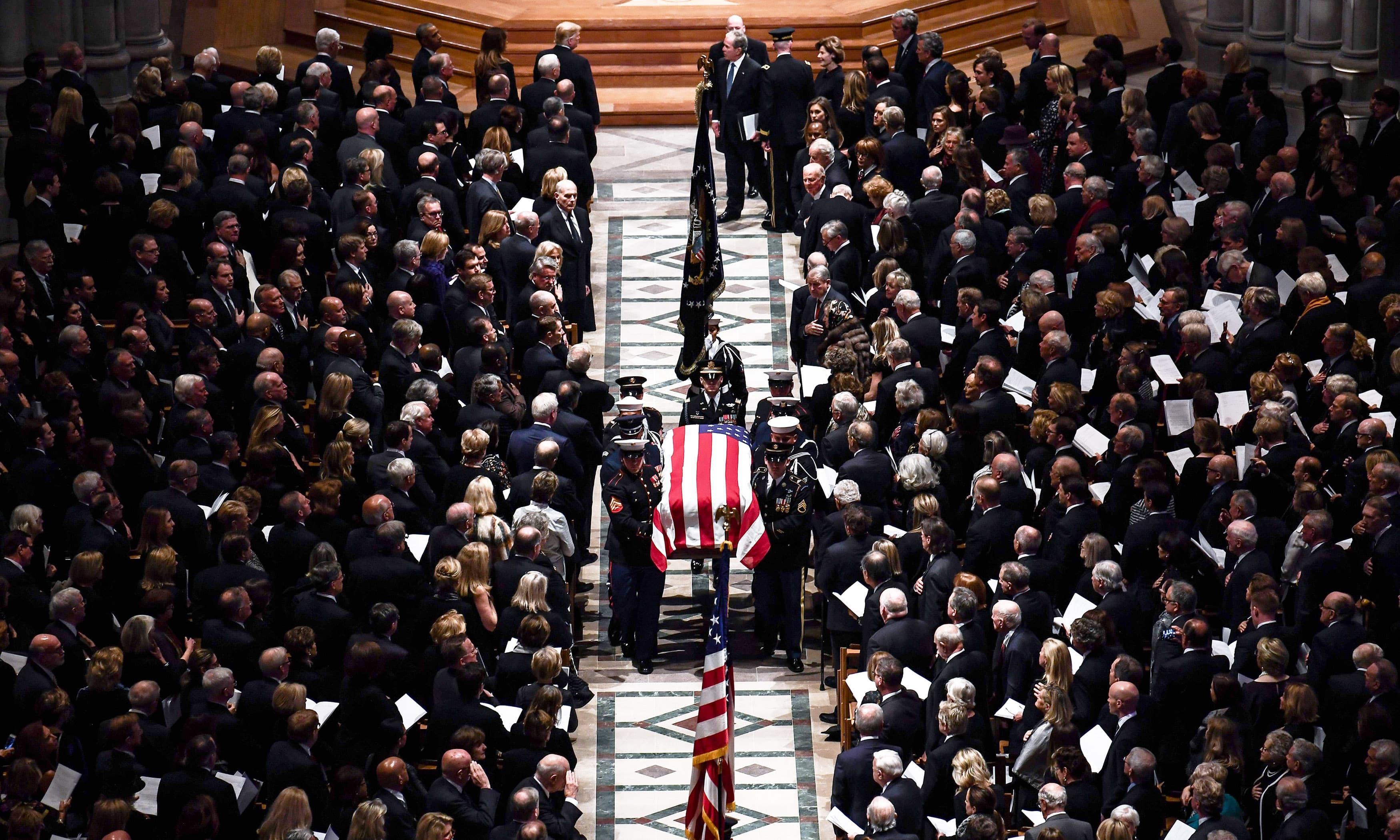The casket of former president George H W Bush is carried out by pallbearers during his state funeral. —AFP