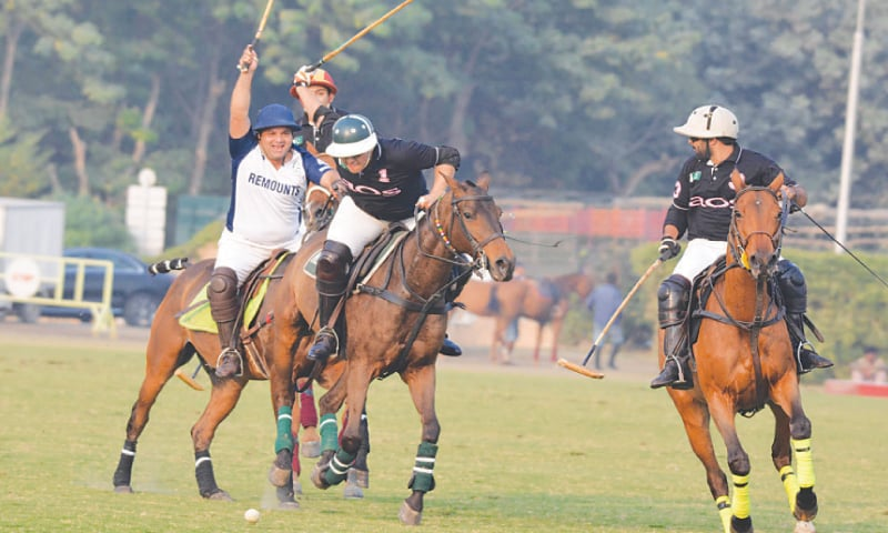 LAHORE: Players of PBG/Remounts and AOS in action during their match of the Lahore Open Polo Championship on Wednesday.—M.Arif/White Star