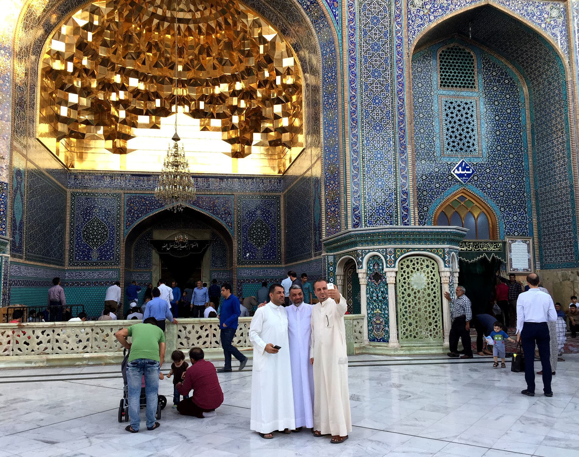 Iraqi pilgrims take a selfie at the golden door to Fatima Masoumeh's shrine in Qom.