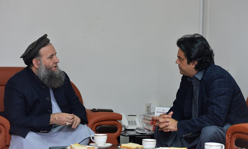 Minister for Religious Affairs Noorul Haq Qadri (L) and prime minister's aide Usman Dar (R)  discuss measures to include religious seminaries' students in youth programme. — Photo by author