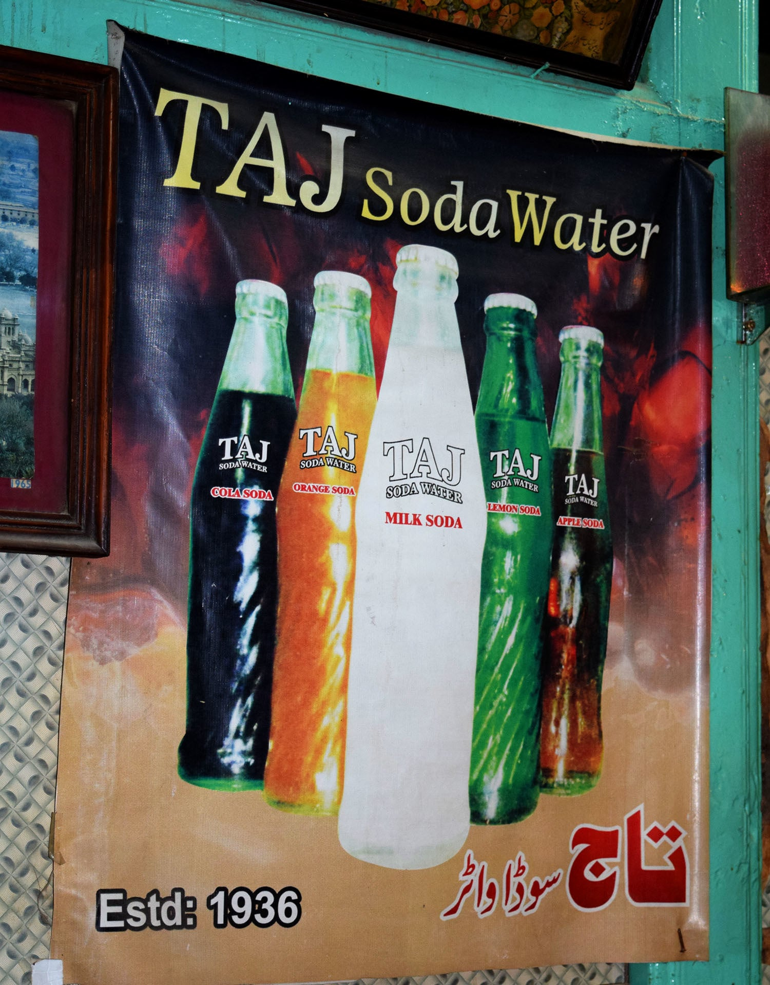 A poster at the Taj Soda Company's shop.