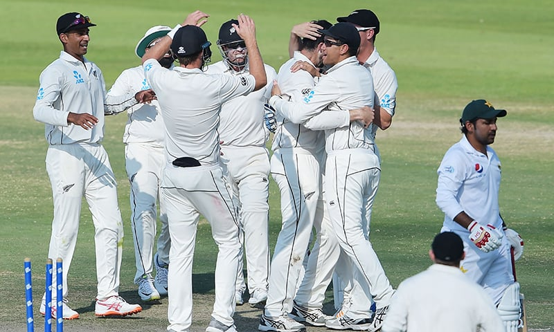 New Zealand cricketers celebrate after the dismissal of Pakistani captain Sarfraz Ahmed. — AFP