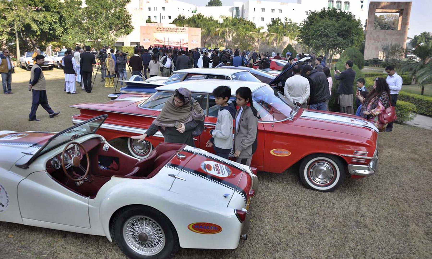 A family stops to examine the pristine interior of a two-seater displayed at the Serena Hotel in Islamabad. —APP