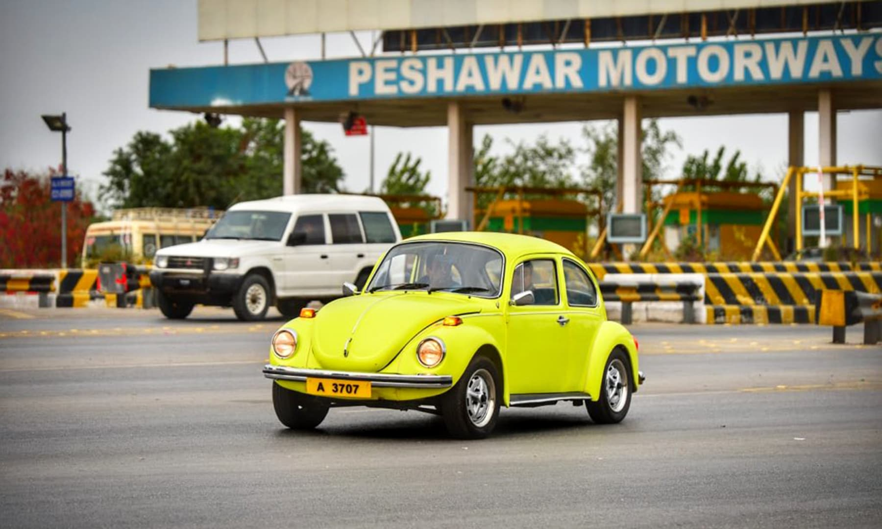 A brightly-coloured Volkswagen seen on the Peshawar Motorway. —@PTIofficial