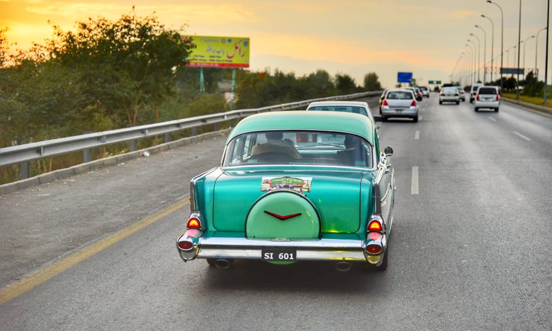 A setting sun reflected in the turquoise exterior of this classic car. —@PTIofficial