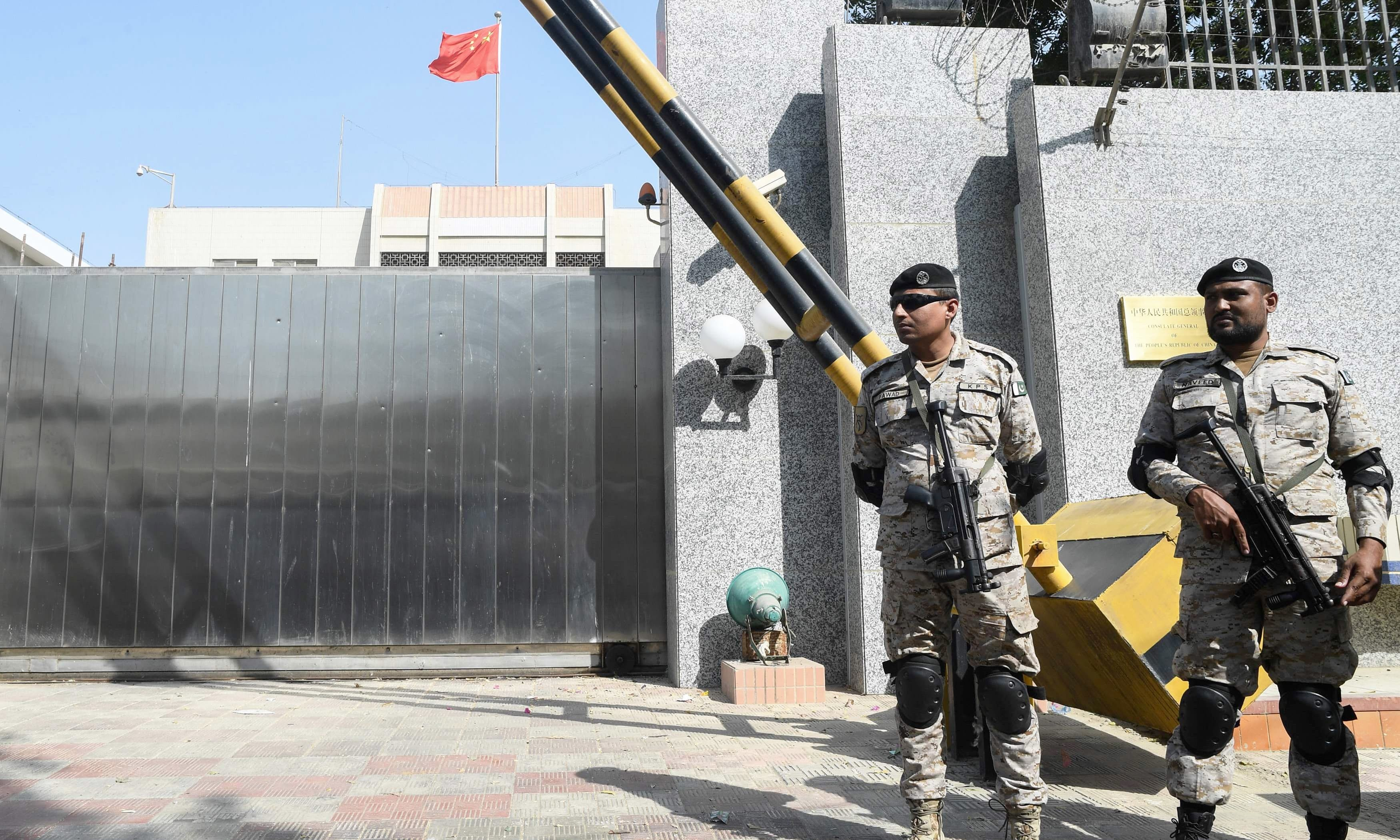 Rangers personnel stand in front of the Chinese consulate after an attack in Karachi on Nov 23. —AFP