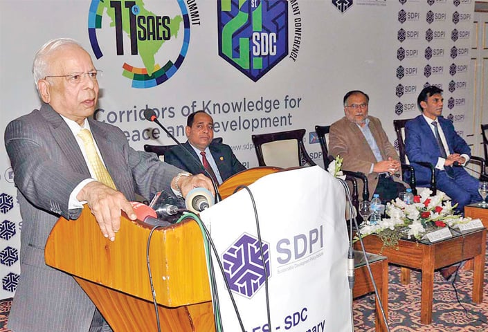 Adviser to the Prime Minister for Institutional Reforms and Austerity Dr Ishrat Hussain speaks at the conference on Friday. — APP