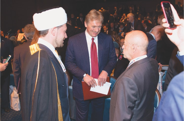 President of the Institute of Oriental Studies Professor Vitaly V. Naumkin greets Sergey Peskov, press-secretary of Russian President Vladimir Putin and a Muslim clergyman