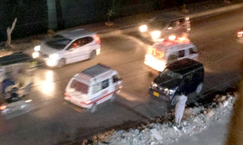Rescue services rushing to the location of the blast. —Dawn.com
