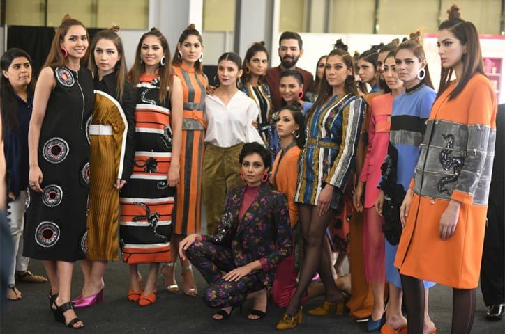A model wears Hussain Rehar and the designer backstage with his models at PFDC Sunsilk Fashion Week | Faisal Farooqui@Dragonfly