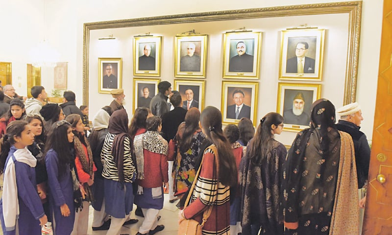 ISLAMABAD: Visitors view a presidents' portrait gallery at the Aiwan-i-Sadr on Saturday.—Tanveer Shahzad/White Star