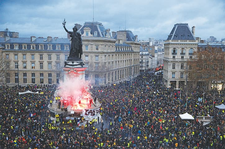 PARIS: A view of the Place de la Republique as protesters gather during a national day of protest by the 'yellow vests' movement on Saturday. In familiar scenes, the provincial poor and struggling middle classes poured into the capital for a fourth round of protests over taxes and inequality.—Reuters
