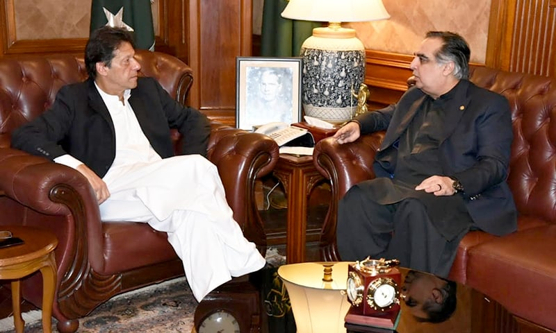 Prime Minister Imran Khan discusses ongoing development projects with Sindh Governor Imran Ismail at the Governor House. —Photo courtesy: Sindh Governor House