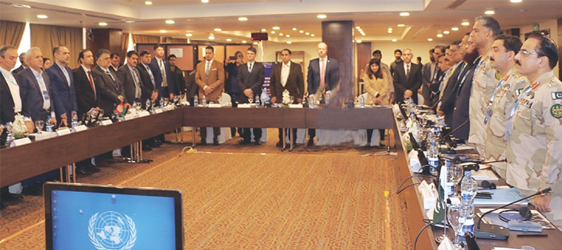 ISLAMABAD: Counter-narcotic officials from Afghanistan, Iran and Pakistan stand for a national anthem during the Triangular Initiative meeting on Tuesday.—White Star