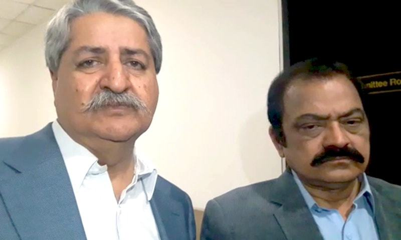 PPP's Naveed Qamar (L) and PML-N's Rana Sanaullah speak to reporters at the parliament after a meeting with a government delegation. — DawnNewsTV