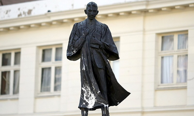 In this file photo, a statue of Mahatma Gandhi is seen after it was vandalised with white paint at Gandhi Square in Johannesburg on April 13, 2015. — Reuters