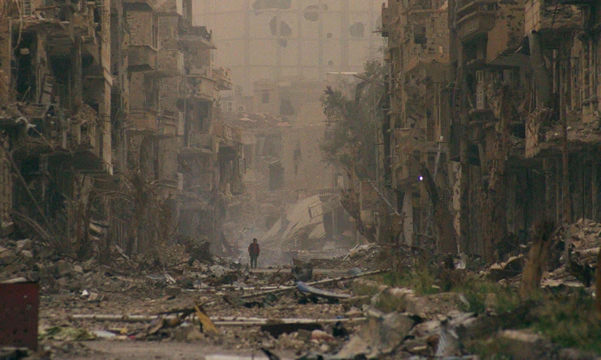 A child walks past damaged buildings in Deir ez-Zor, Syria   Reuters