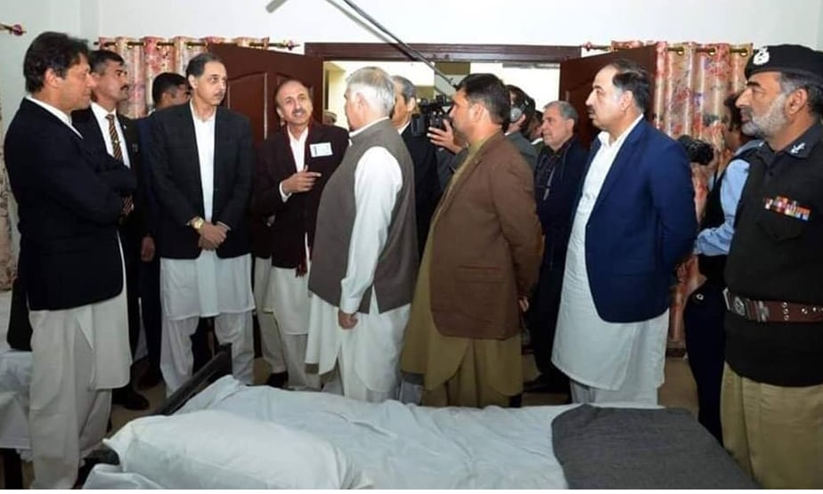 PM Khan is briefed on a shelter home in Peshawar. — PID