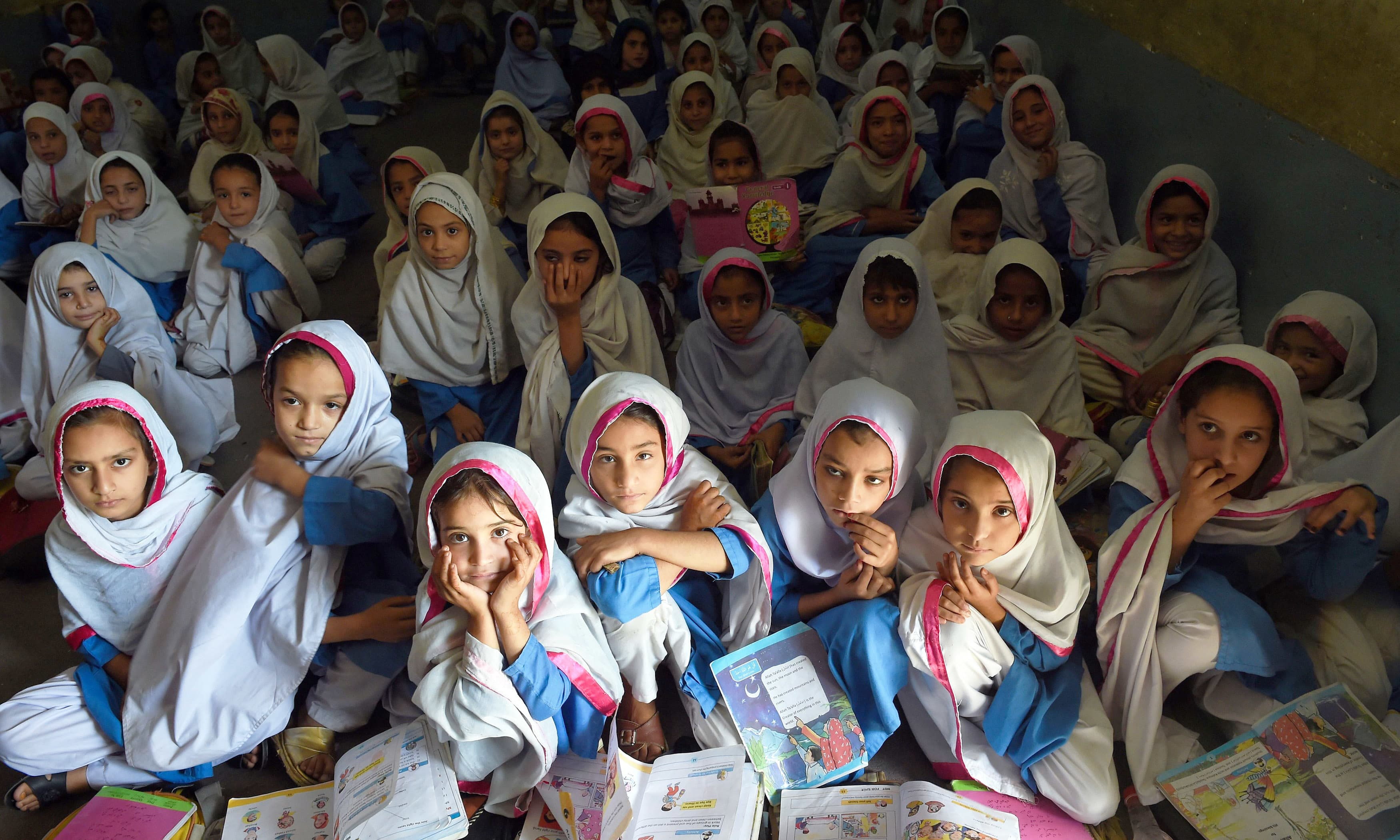Girls attend a class in a school in Mingora, Swat. —AFP