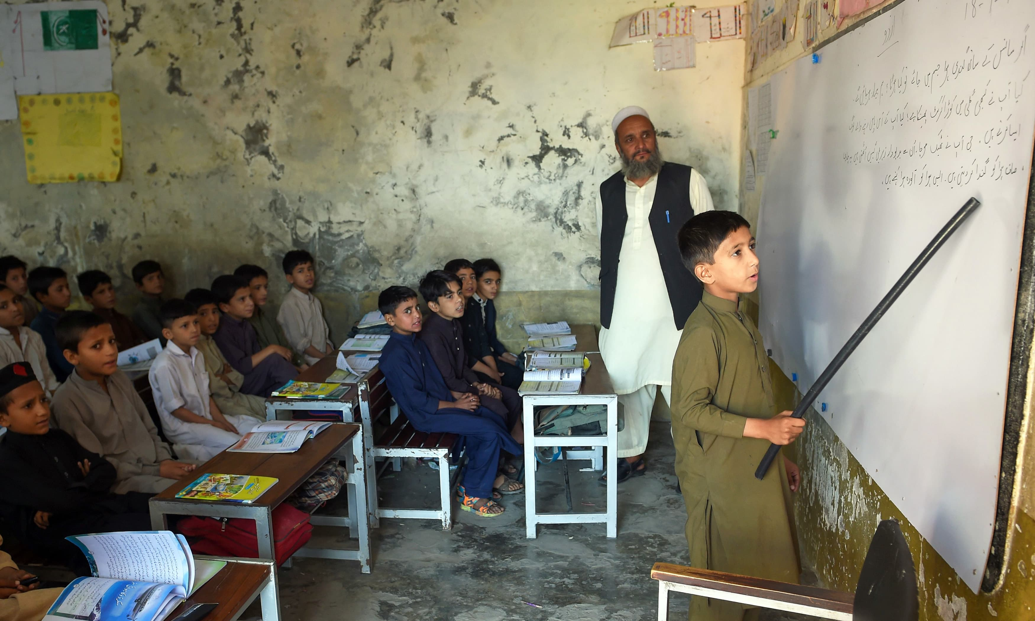 Boys attend a class at a school in Mingora, Swat. —AFP