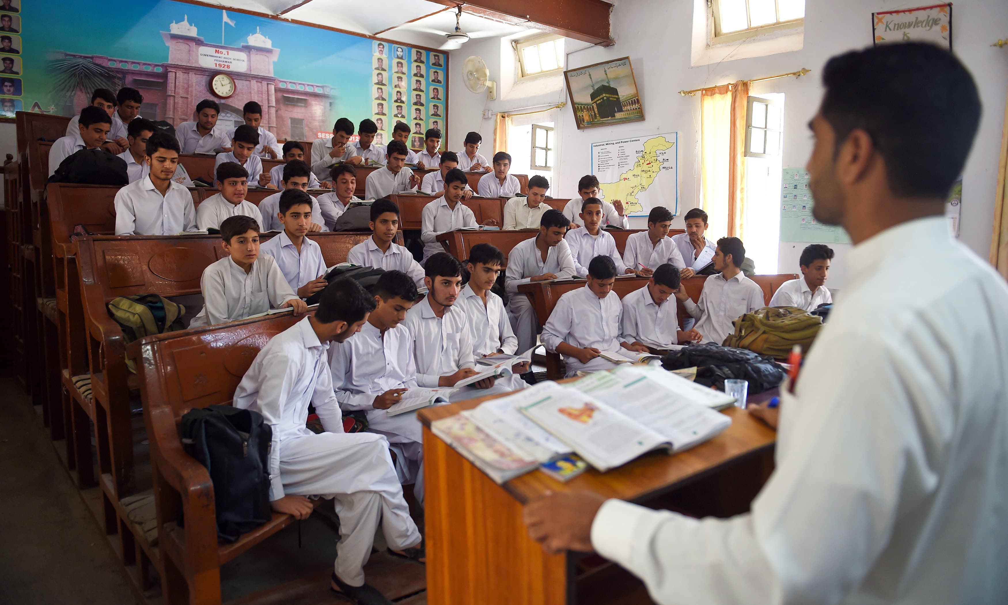 Students attend a class at a government school in Peshawar. —AFP