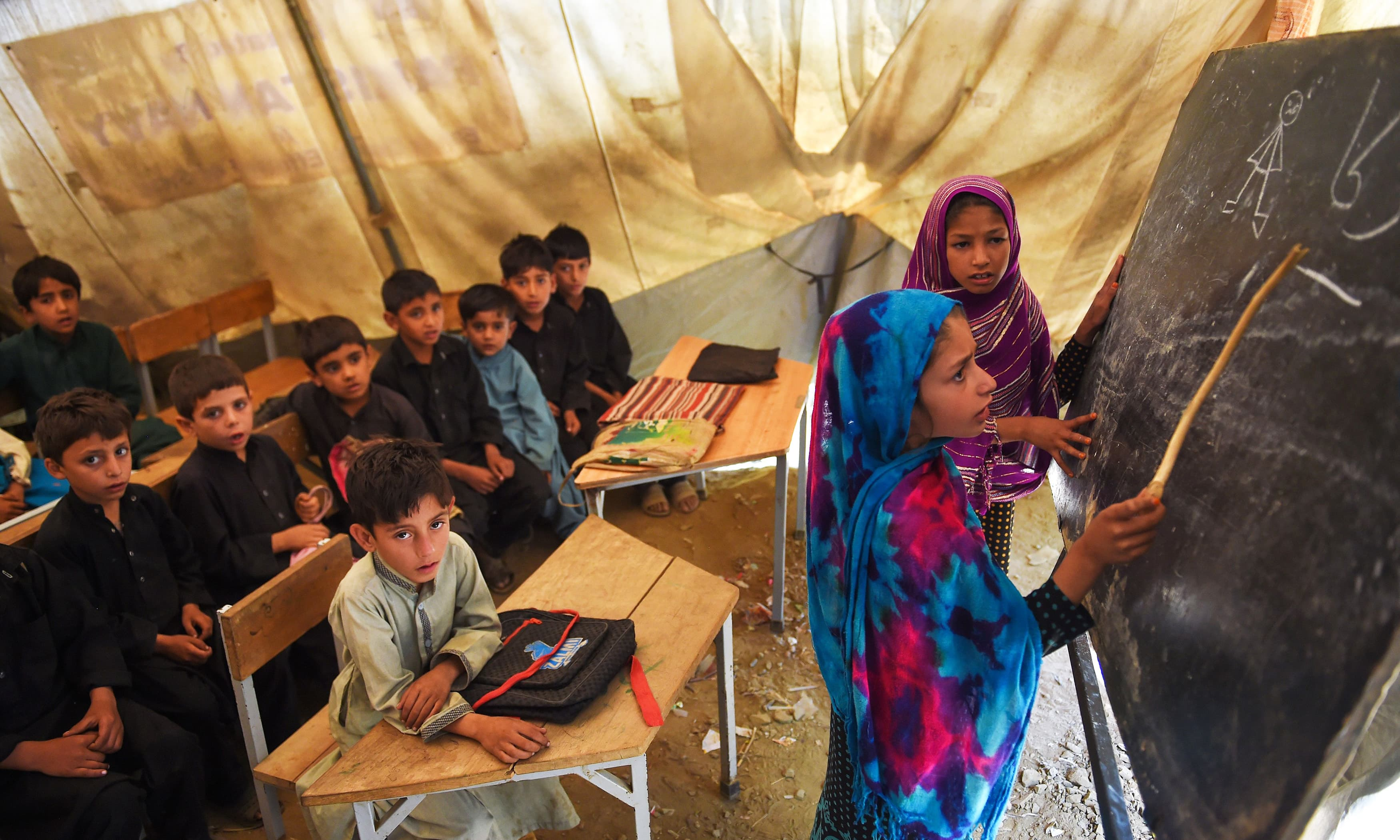 Children attend a class at a tent school in Tanjai Cheena, a village in Swat Valley. —AFP
