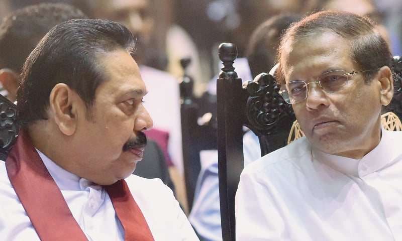 Colombo: In this Nov 30 file photo, Sri Lanka's President Maithripala Sirisena (right) listens to outgoing prime minister Mahinda Rajapakse during a ceremony granting employment to social service workers.—AFP