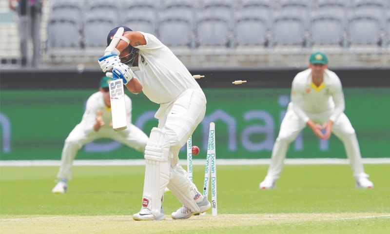 PERTH: India opener Murali Vijay is bowled by Australian paceman Mitchell Starc during the second Test at Perth Stadium  on Saturday—AP