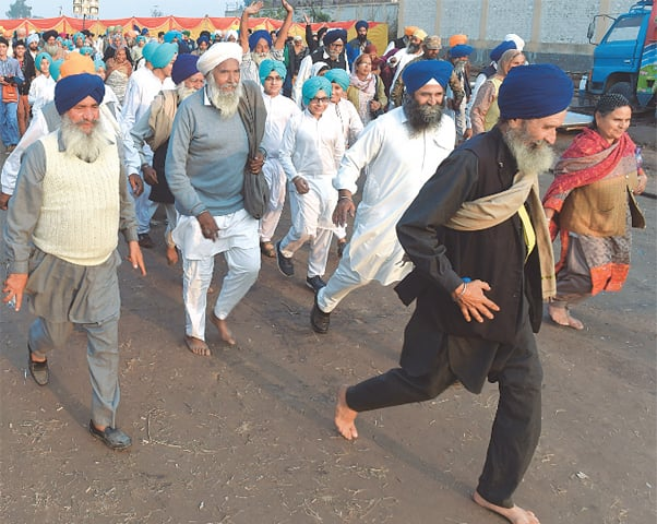 Sikh pilgrims walking towards the Gurdwara at Kartarpur | White Star