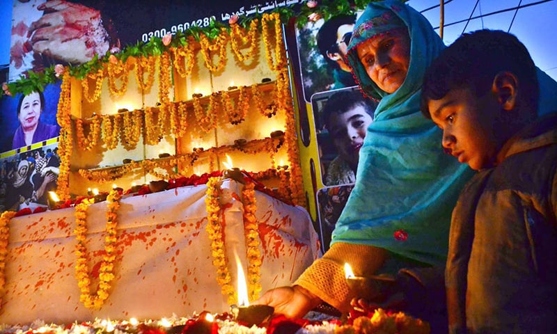 People light candles on the occasion of 4th anniversary of the terrorist attack on Army Public School Peshawar in Sargodha on Sunday. — APP