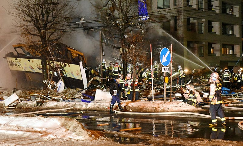 Firefighters carry on rescue works after an explosion at a restaurant in Sapporo, in the northern Hokkaido prefecture. — AFP