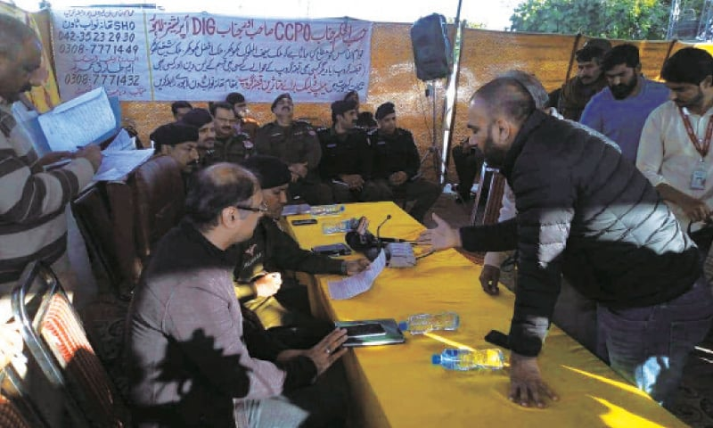 Police set up a camp at Johar Town to receive public complaints against land grab. — White Star