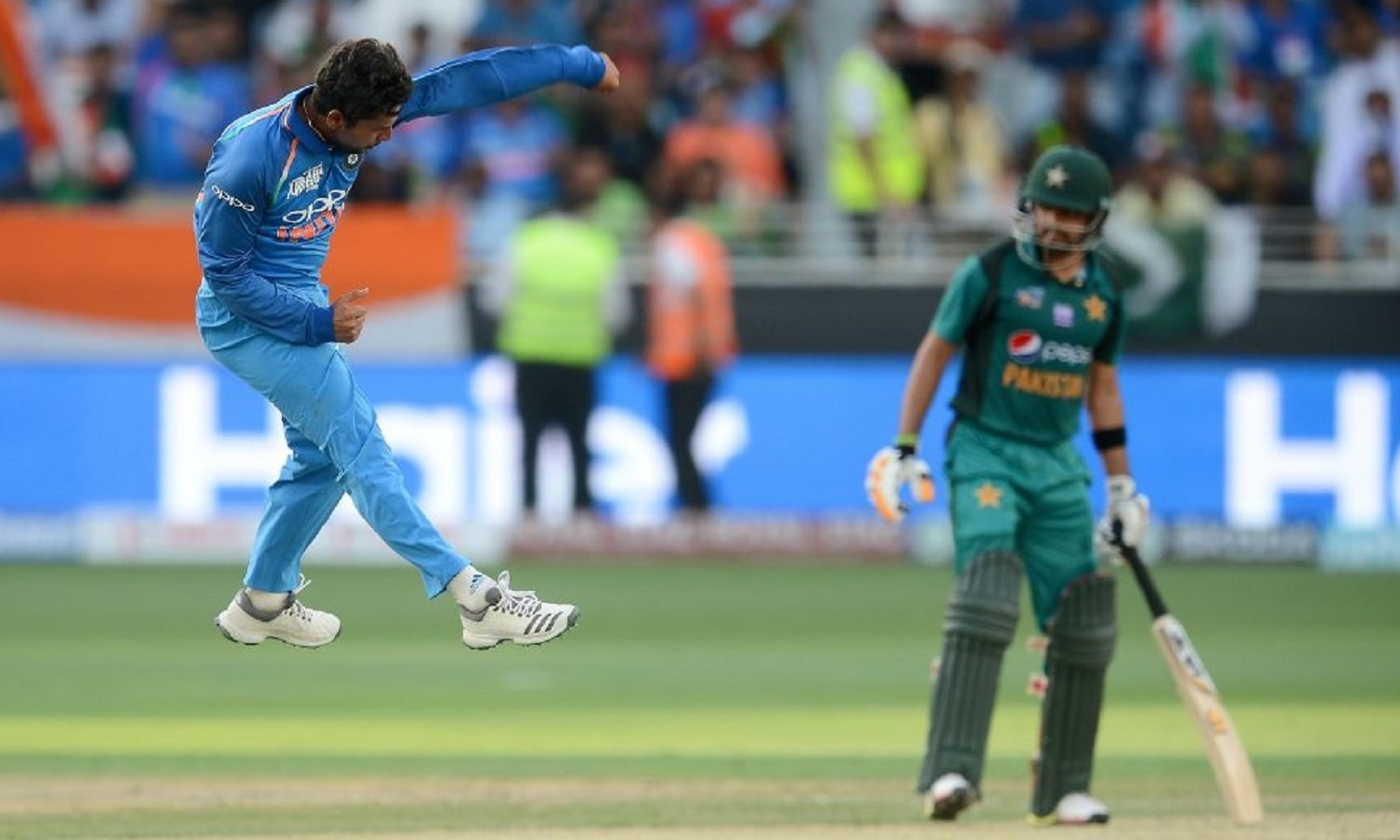 An Indian player celebrates as a Pakistani counterpart looks on during their Asia Cup encounter. — AFP